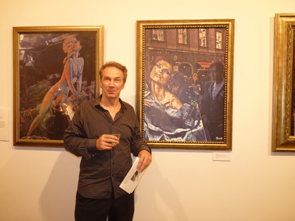 Yury poses in front of two frames from Slawek's All About Sex series