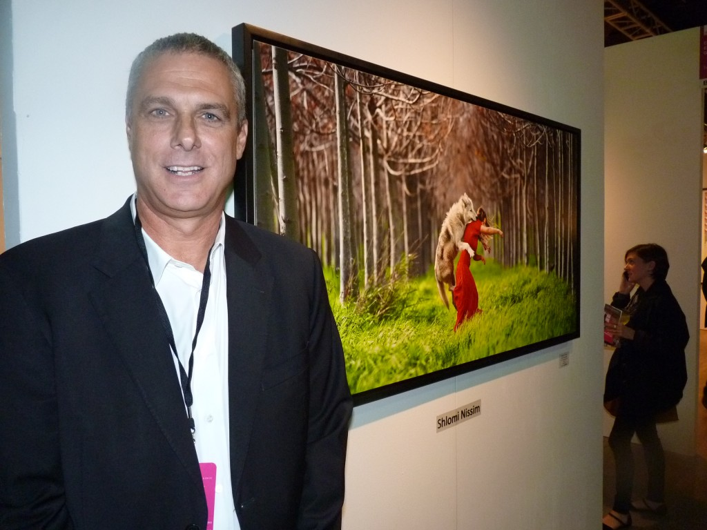 "Shlomi Nissim's Little Red Ridinghood (C-print 40""x60"" Edition of 8) $6000), actually not an attack but a romp with Red Riding Hood whose family brought her and the wolf up in a cave in Israeli (they were a religious sect, long story)  explains Yaron Lavitz at Contempop Gallery  of Tel Aviv ,  who would be pleased by selling four of the striking  images by Sunday night"
