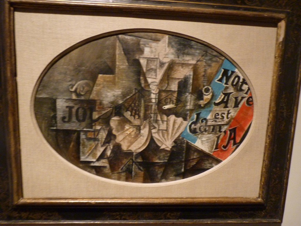 "The relief of color: Bold color reentered Braque's and Picasso's work in spring 1912, partly in response to the Italian Futurists' brilliantly hued canvases, which debuted in Paris earlier that year. Picasso used industrial paint to reproduce the cover of a pamphlet, ""Our Future Is in the Air,"" issued by the Michelin tire company to raise support for the government's aviation program. The blue, white, and red stripes refer to the French flag. Cubists enjoyed aviation references because they viewed their art as similarly groundbreaking. As an inside joke, Braque and Picasso compared their creative partnership to that of the Wright brothers.   The Scallop Shell: ""Notre Avenir est dans l'Air"" Pablo Picasso (Spanish, Malaga 1881–1973 Mougins, France ) Date: Paris, spring 1912 Medium: Enamel and oil on canvas Dimensions: Oval, 15 × 21 3/4 in. (38.1 × 55.2 cm) Classification: Paintings Credit Line: Promised Gift from the Leonard A. Lauder Cubist Collection Rights and Reproduction: © 2014 Estate of Pablo Picasso / Artists Rights Society (ARS), New York On view in Gallery 199"